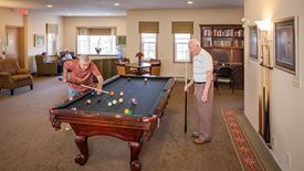 residents playing pool at Chartwell Colonial Retirement Residence
