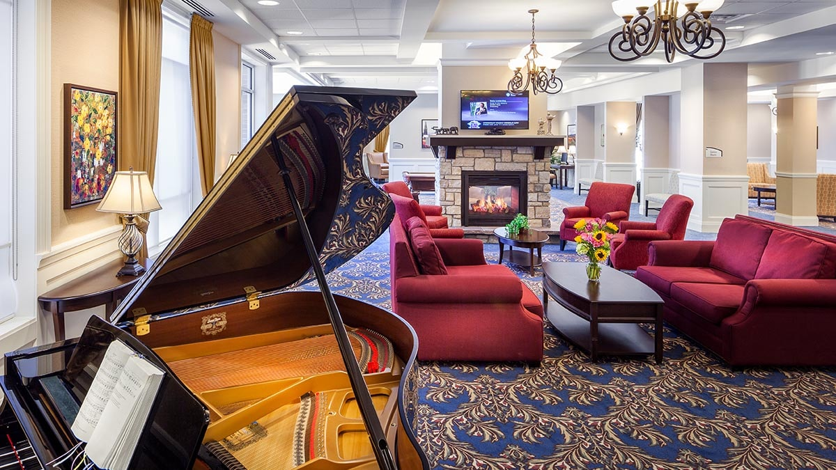piano in lobby at Chartwell Deerview Crossing Retirement Residence