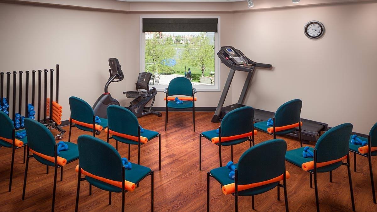 exercise room at Chartwell Harbours Retirement Residence