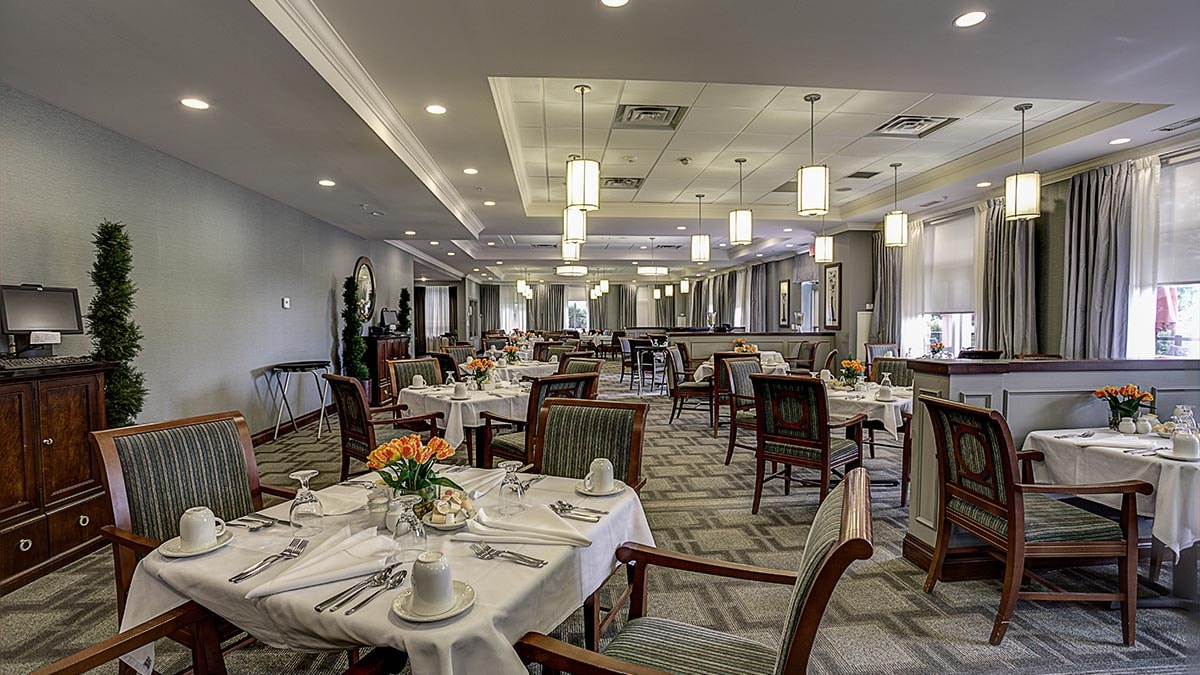 large, modern dining room at Chartwell Hollandview Trail Retirement Residence