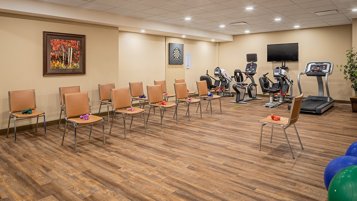 spacious fitness area at Chartwell Montgomery Village retirement residence