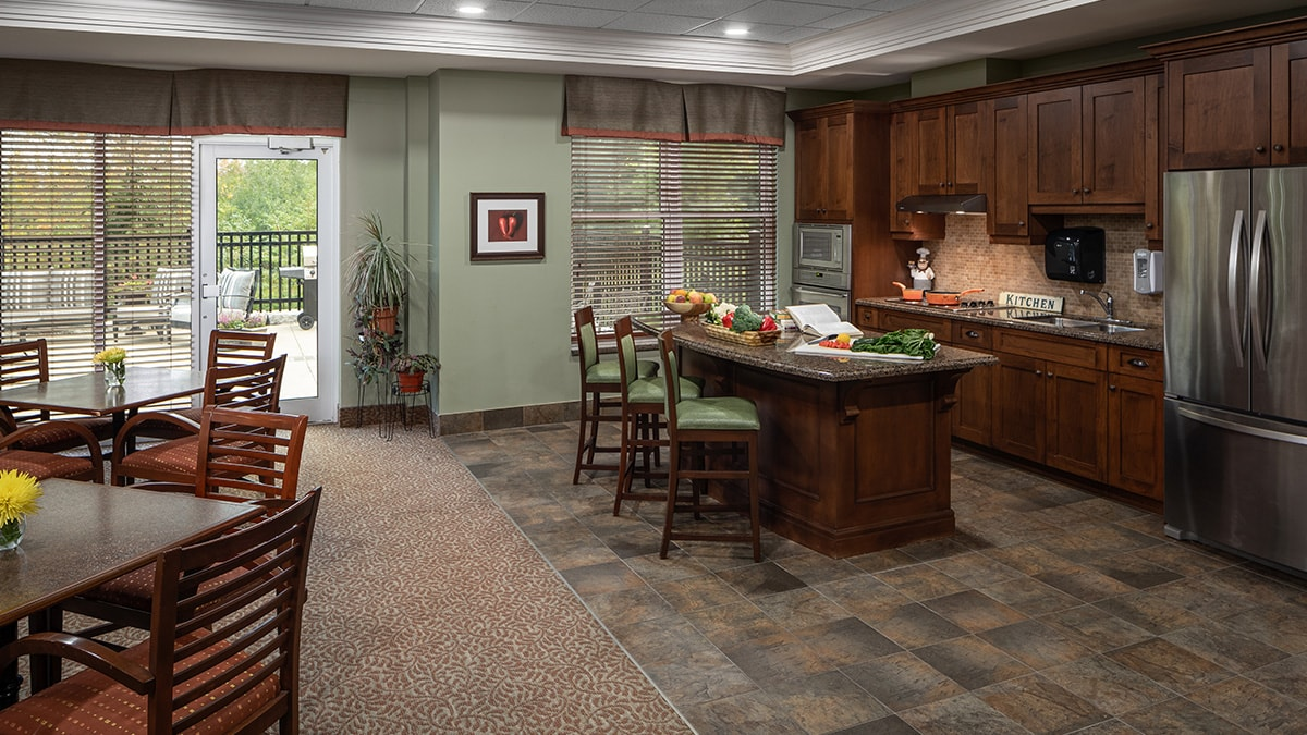 Beautiful common area with kitchen at Chartwell Montgomery Village retirement residence