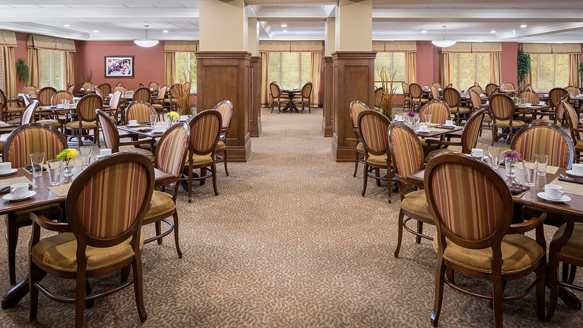 Large common dining area at Chartwell Montgomery Village retirement residence