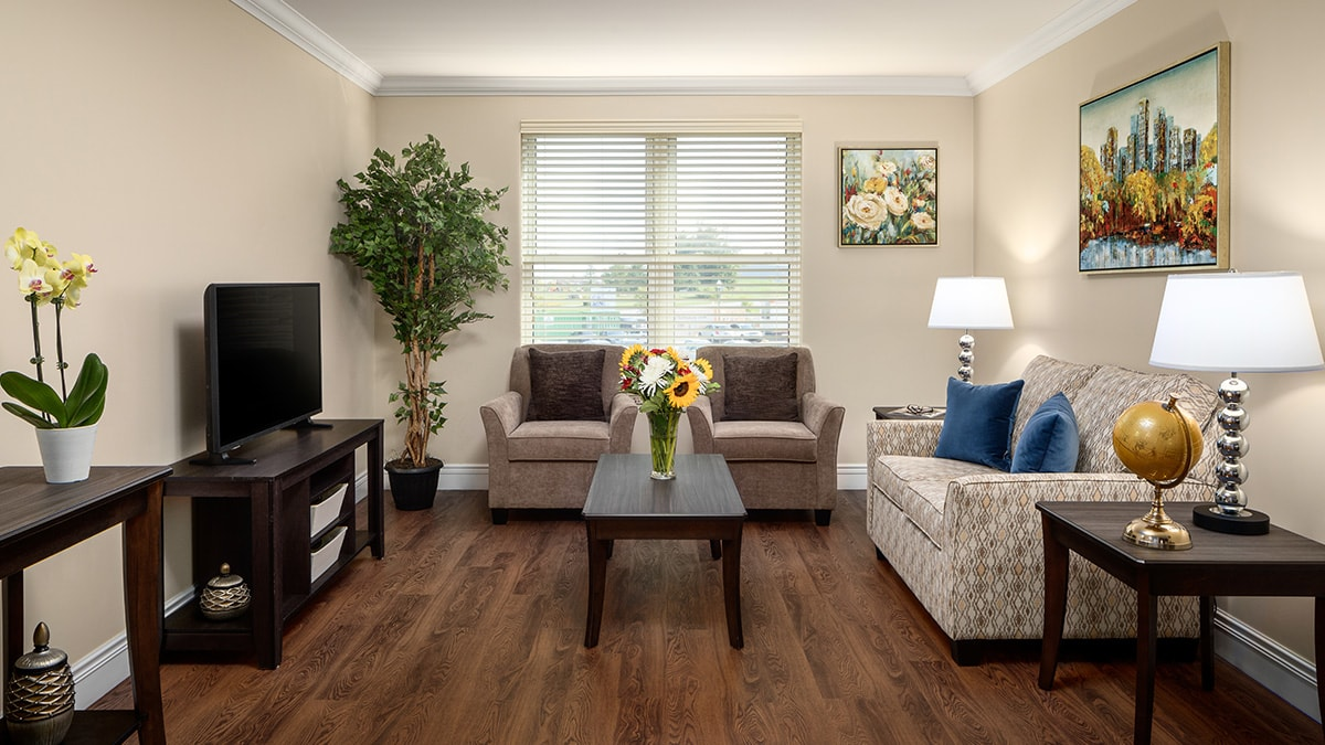 Modern suite living room at Chartwell Montgomery Village retirement residence