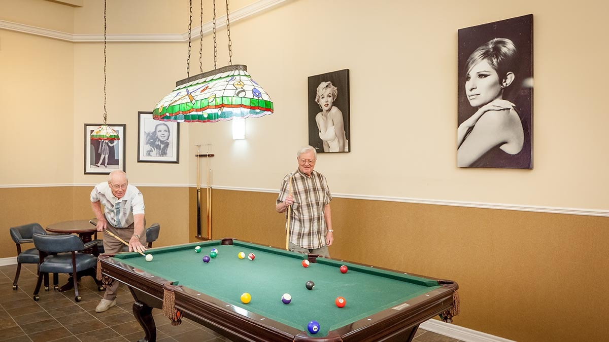 residents playing pool at Chartwell Oak Park LaSalle Retirement Residence
