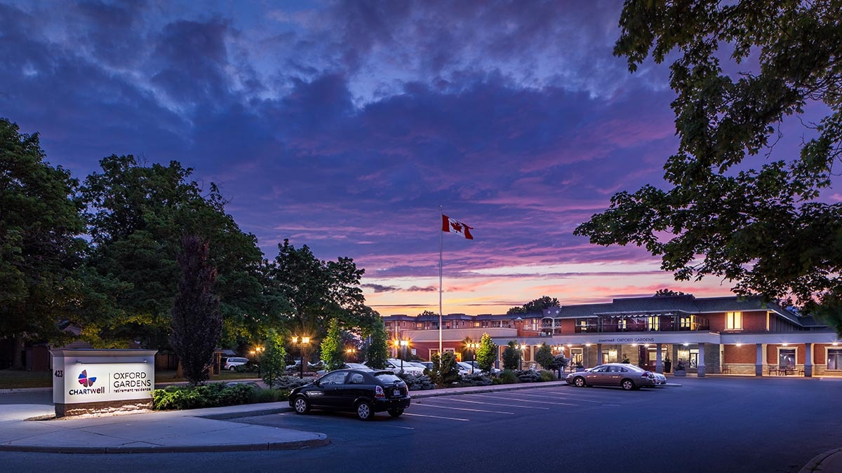 night time exterior of Chartwell Oxford Gardens Retirement Residence
