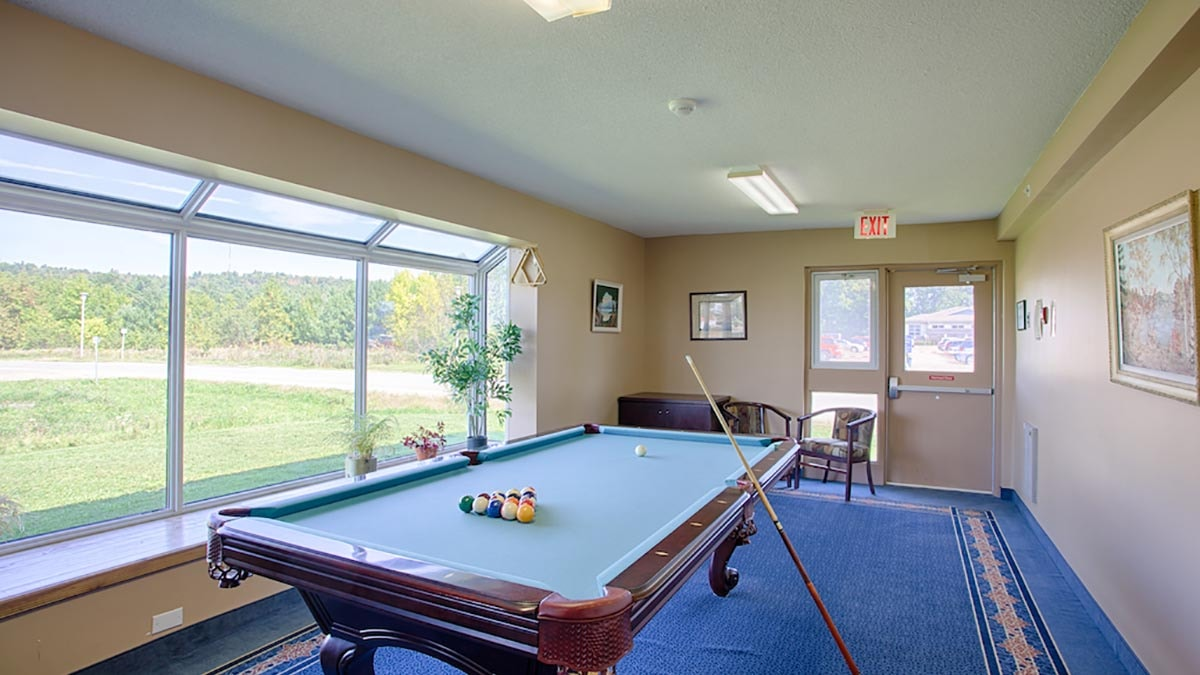 billiards room at Chartwell Quail Creek Retirement Residence