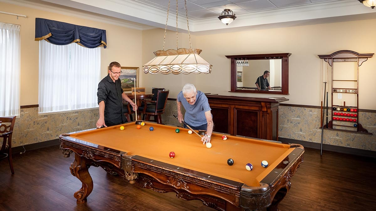 residents playing pool at Chartwell Riverside Retirement Residence