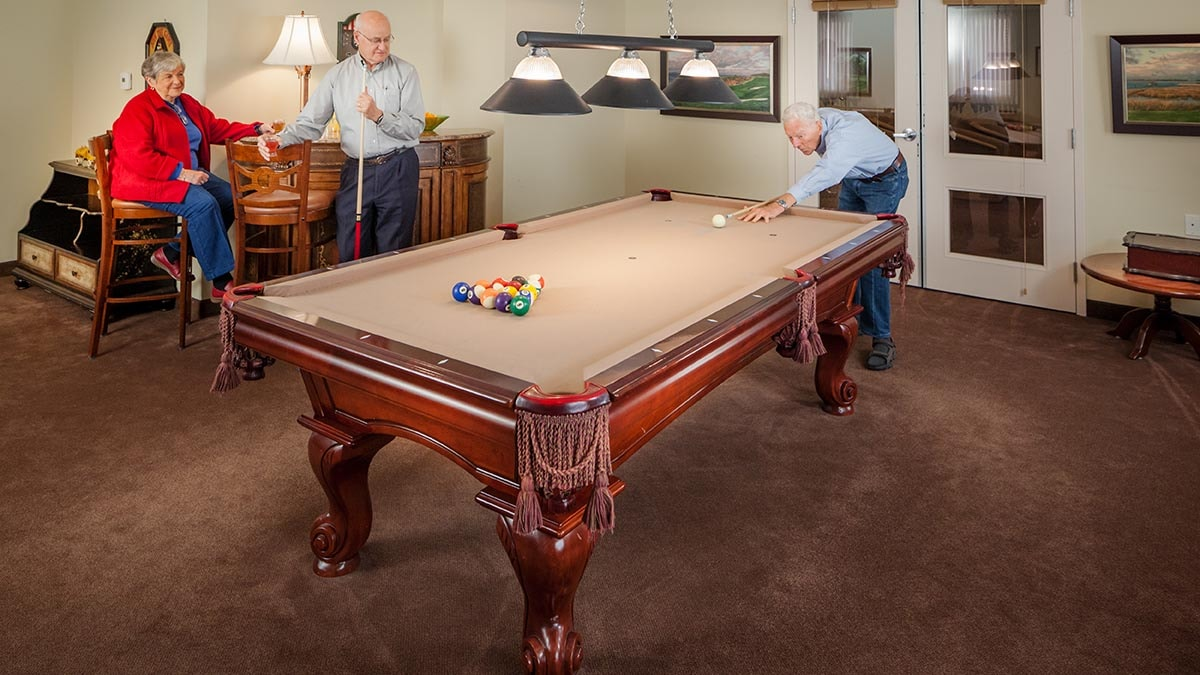 residents playing pool at Chartwell Thunder Bay Retirement Residence