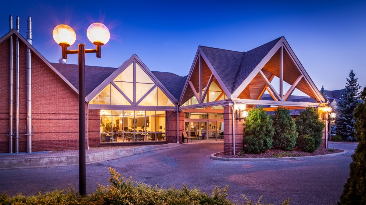 nighttime exterior of Chartwell Leamington Retirement Residence